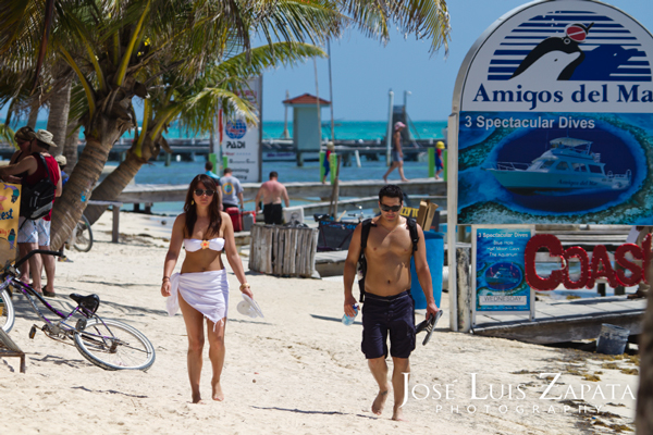 San Pedro Ambergris Caye Belize. Tourist walking down our beautiful white sandy beaches.  © 2011 Jose Luis Zapata Photography.