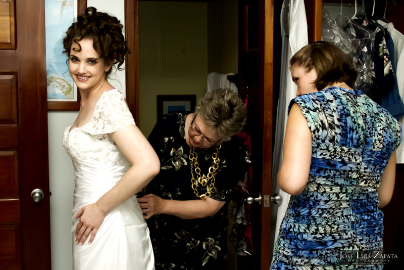 Bride getting ready with help from mom and friend.