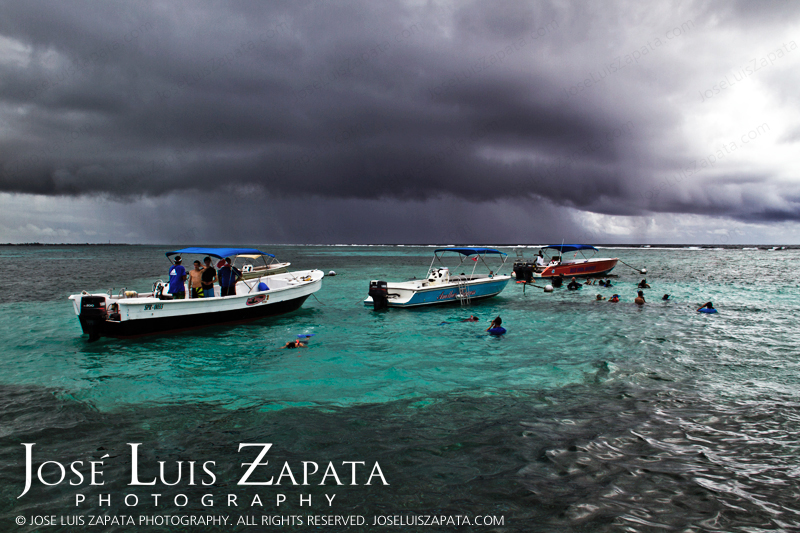 Tourist enjoying Hol Chan Marine Reserve in Ambergris Caye, Belize. © 2011 Jose Luis Zapata Photography. All Rights Reserved.